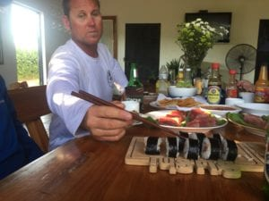 eating beautiful sushi rolls from that days catch while on vacation at fishing lodge
