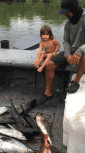 alex and ryann examining their catch on the tuna coast of panama after panama tour
